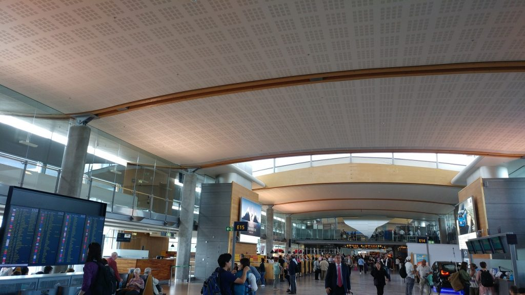 Large wood laminated structural elements visible in the airport.
