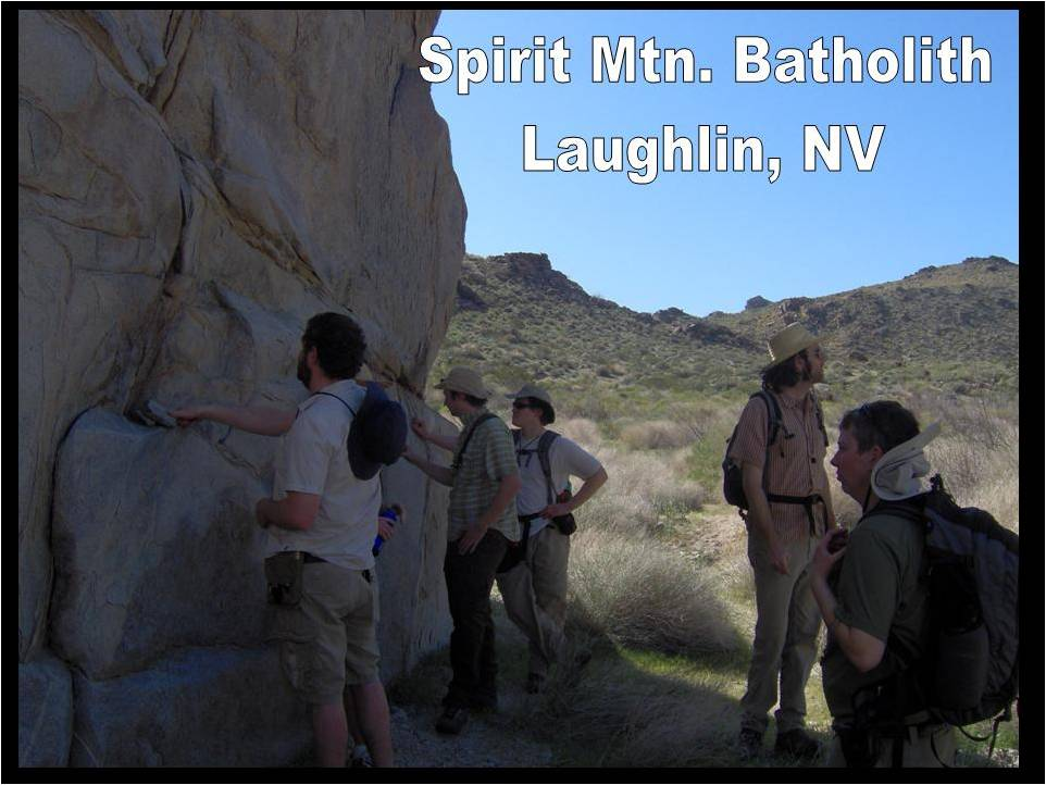 Here they are inspecting a large outcrop of granite at the Spirit Mountain Batholith while enjoying a spot of shade.