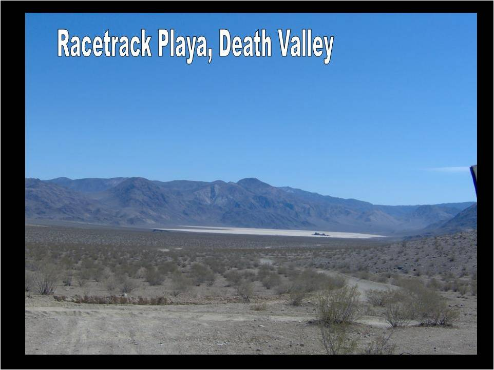 The approach to Racetrack Playa, which is fairly isolated within Death Valley National Park. The group had to drive a little over an hour on a dustry gravel raod to see this oddity. From afar, you can see that it looks like a typical stretch of desert sand. The black outcrop within the playa is called the Grandstand.