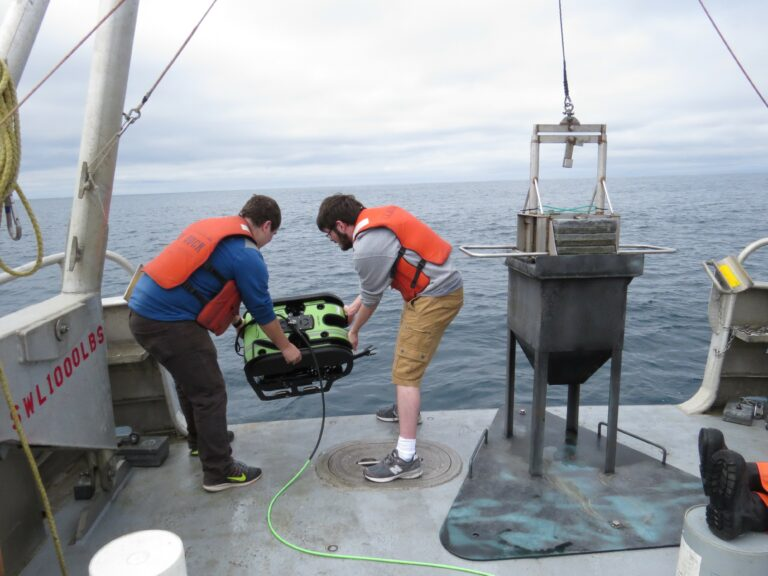 In April 2016, Oregon State University engineering doctoral students Dylan Jones and Seth McCammon deploy a Seabotix remotely operated vehicle to perform an autonomous underwater survey at the North Energy Test Site off the coast of Newport, OR.