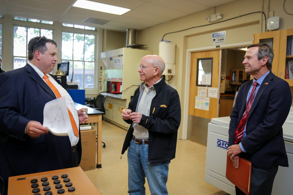 Oregon State researchers talk with Rep. DeFazio in a campus infrastructure materials lab.