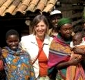 Beth Appert, MPH '09 with mothers and children in Burundi, Beth's birthplace.