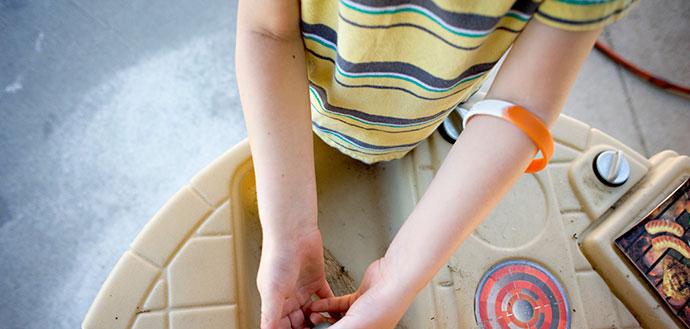 kid wearing wristband