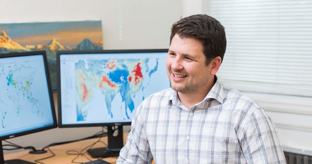 researcher at desk