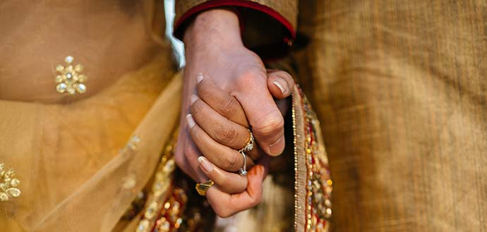 Indian man and woman holding hands