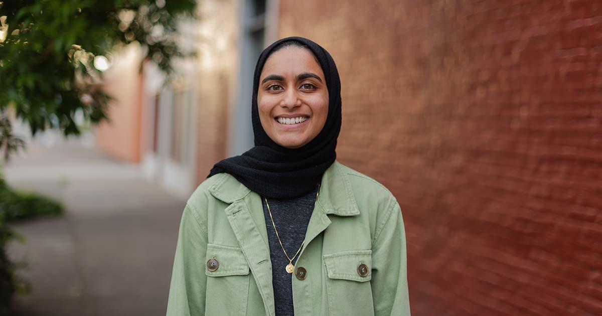 Ammara Molvi smiles near wall