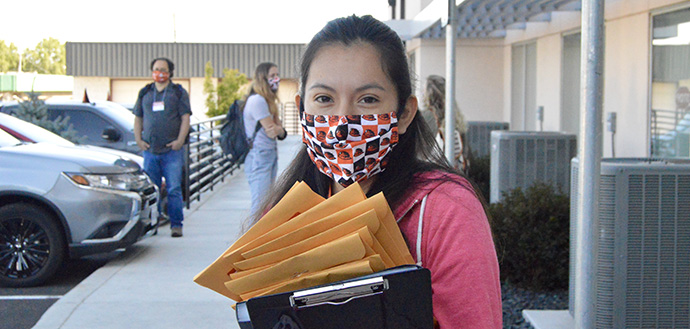 TRACE volunteer wears OSU face mask