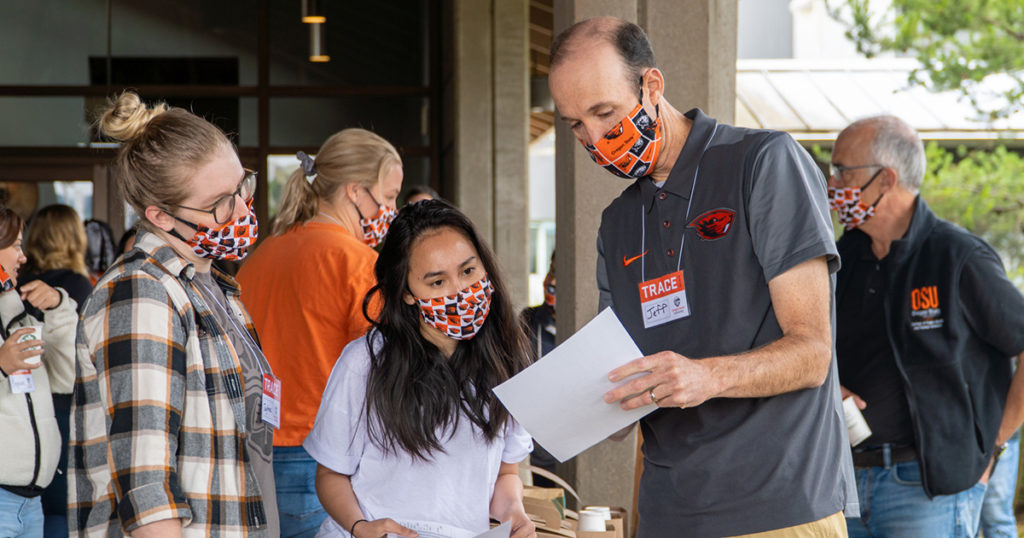 Jeff Bethel discuss TRACE project with volunteers, wearing masks