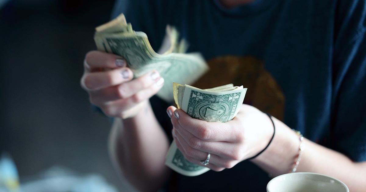 Women wearing ring handles money