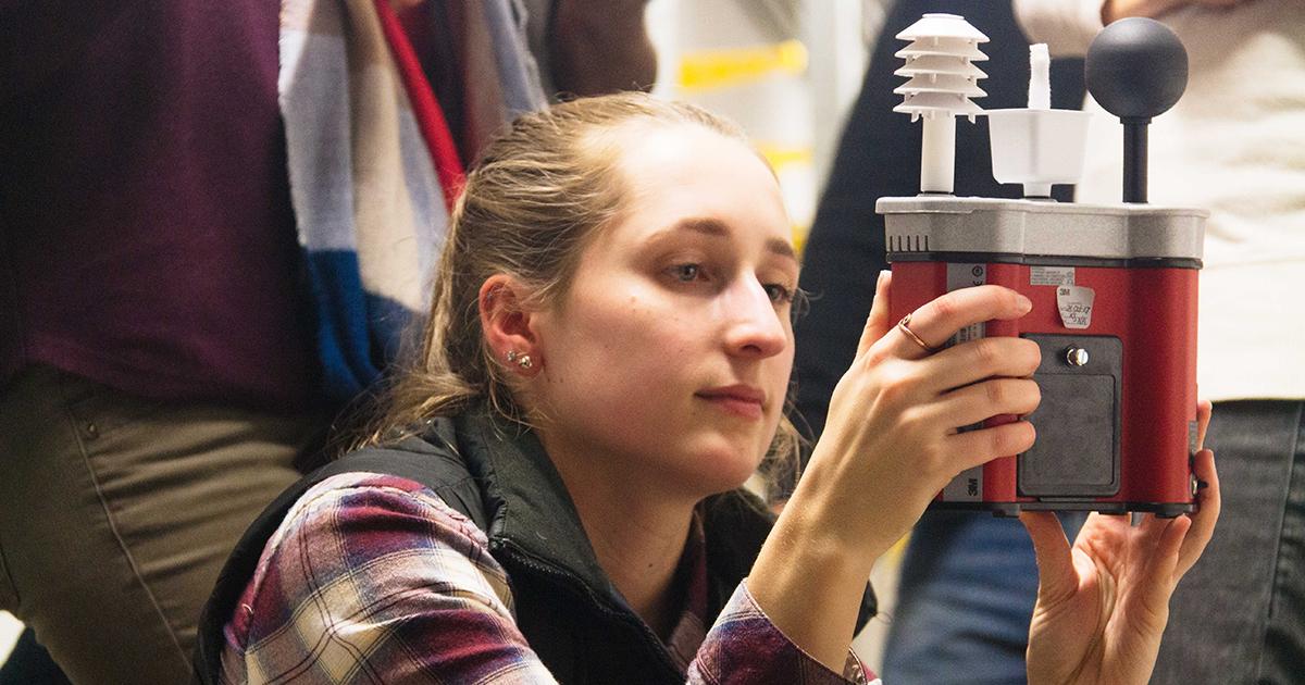 OSU graduate student conducting research in steam tunnel