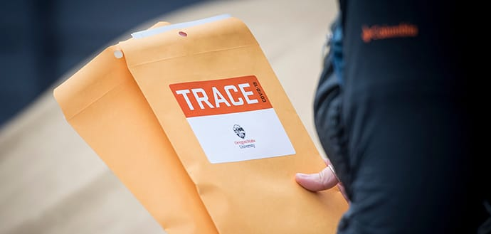 worker holds TRACE envelopes