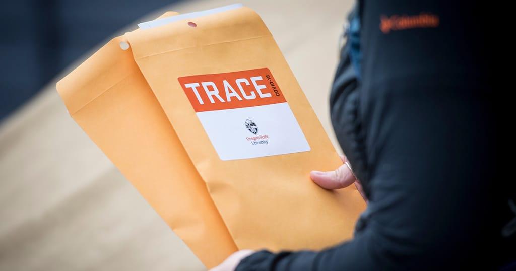 worker holds TRACE envelopes