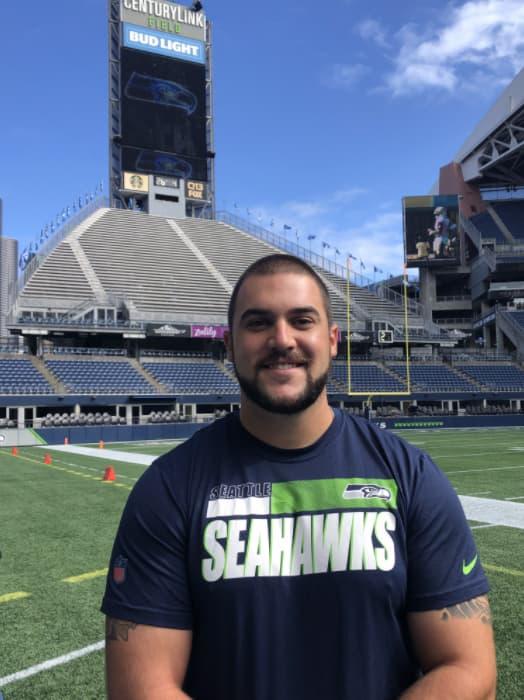 Alex, athletic training graduate student, on Seahawks football field
