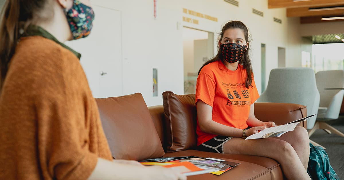 students wearing beaver nation face masks study in common area during fall semester