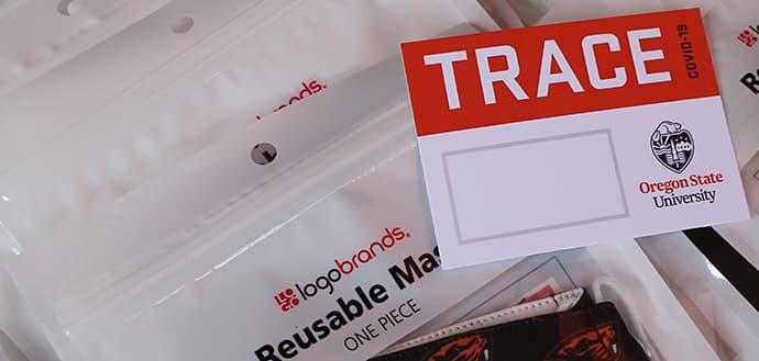 blank TRACE nametag lying on sealed reusable beaver masks