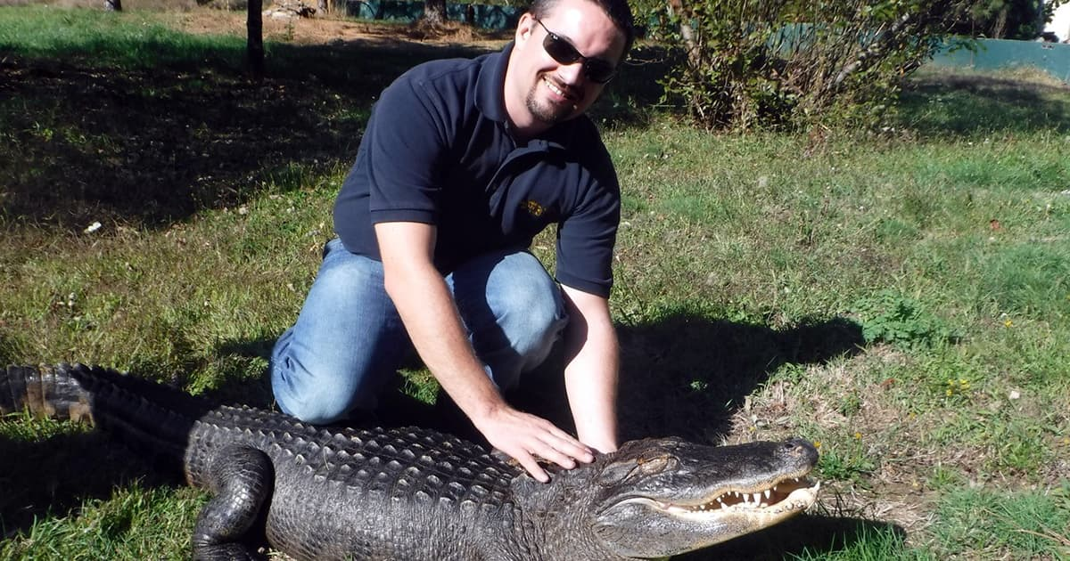 Ryan Scholz poses with alligator