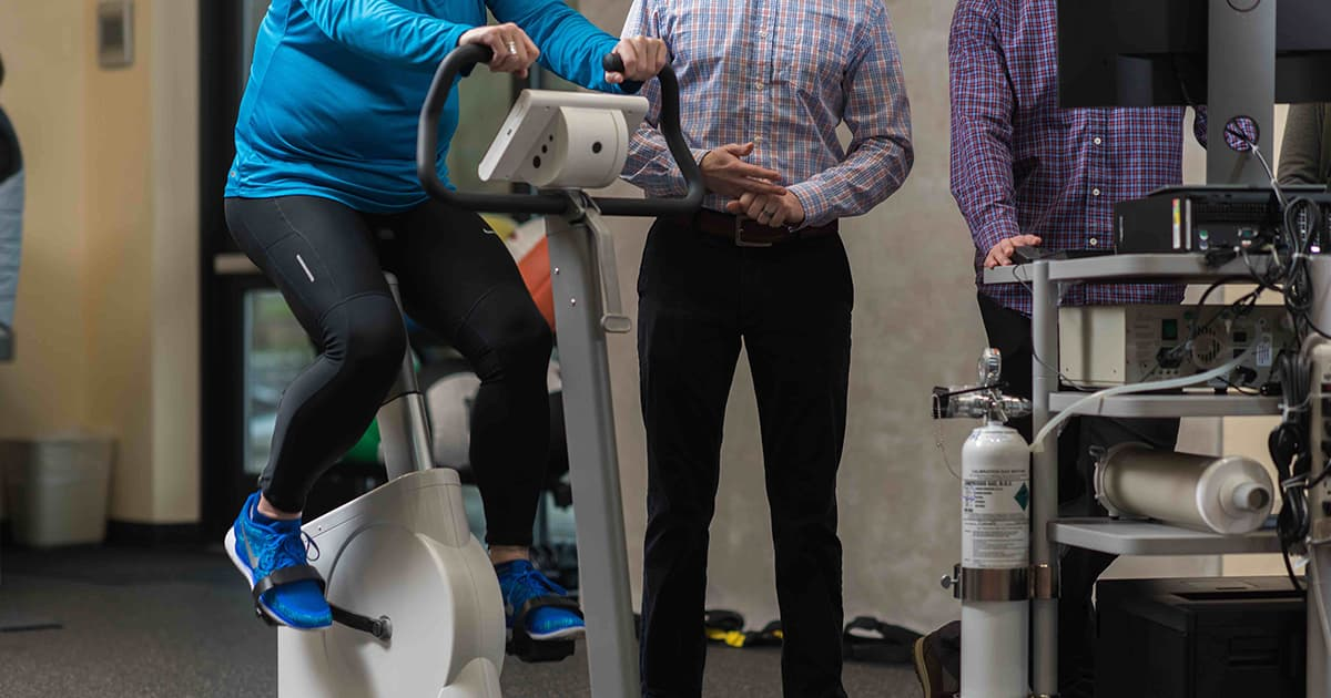 legs on exercise bike