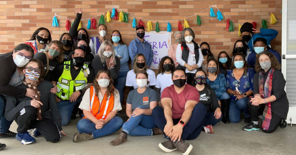 Volunteer group photo, all wearing face masks