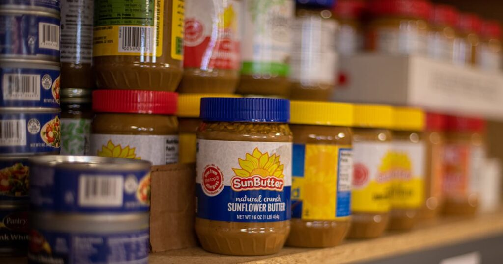 sunflower butter and other canned goods on a shelf