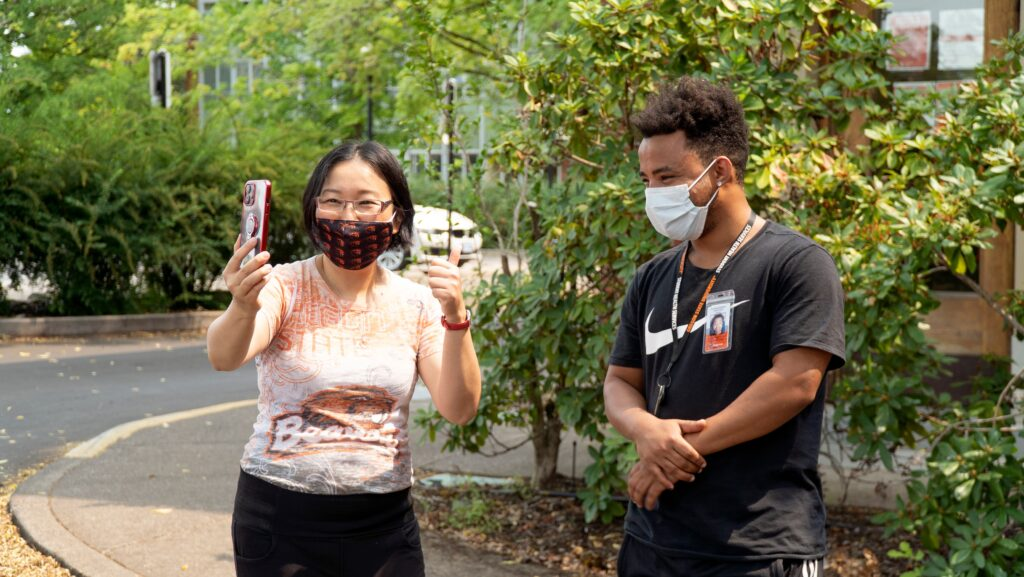 Siew Sun (left) Facetimed Mikayla during the final celebration so she could share her thanks with OSU Student Health Services and Selfless Servings volunteers.