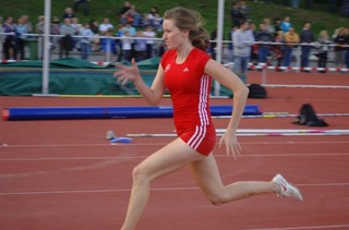 Alex sprinting at a track meet.