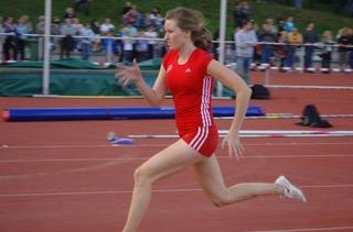 Alex sprinting at a track meet.