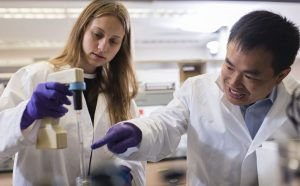 Haelyn Epp and Weihong Qiu preparing motor protein samples in the lab.