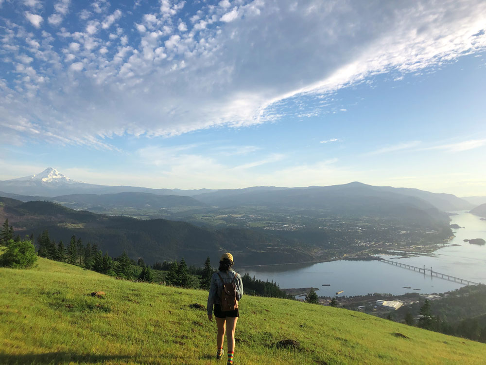 Enjoying the beautiful view at Burdoin Overlook in White Salmon Washington in May 2020. This hike had a spectacular view of Mt. Hood, the Columbia River, and grazing cows.