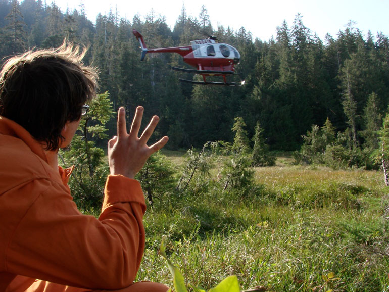 Working in the Tongass National Forest as a soil scientist, our work commute sometimes involved being helicoptered into remote areas, being dropped off in flat alpine wetlands called muskegs, to examine forests and the soils of the surrounding area. My co-worker Jerome Barner waves goodbye for the day.