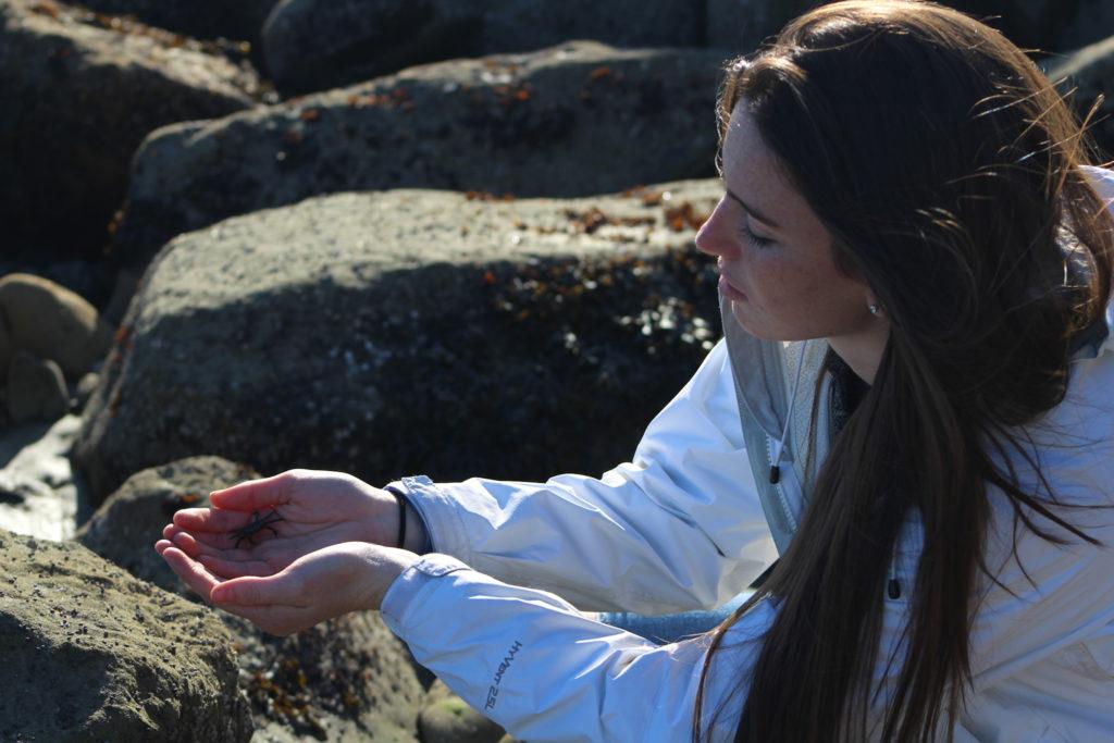 Anita McNally holds a crab.