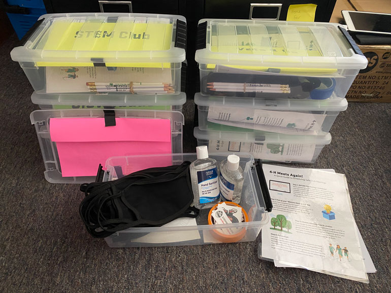 """""""COVID"""" kits for 4-H clubs included hand sanitizer, COVID tracking sheets, tape to mark off six-foot increments, and face masks, along with an informational sheet explaining CDC guidelines for the coronavirus."""