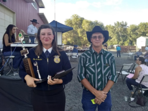 My sister, Ellie, won the highest award given in the county, the Delley Officer Award for sportsmanship and hard work. On the right is Delley's brother, Scott.