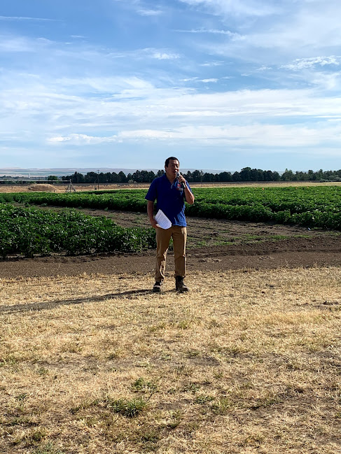 Ray Qin, Extension crop agronomist, speaks at Potato Field Day.