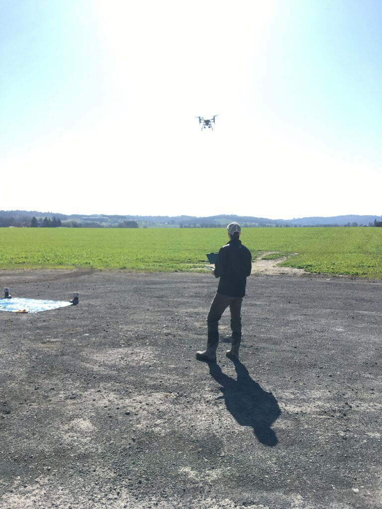 graduate student flying drone